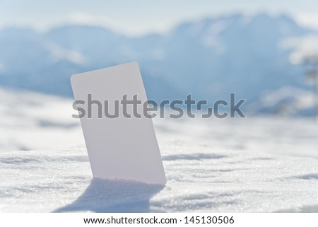 Ski lift pass stuck in snow ready for your design. Concept to illustrate winter sport admission fee - stock photo