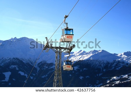 Ski lift with mountains at the background - stock photo