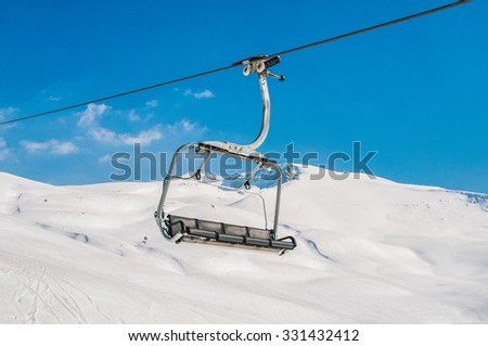 Ski lifts durings bright winter day - stock photo