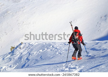 Ski mountaineer during difficult descent on icy slope - stock photo