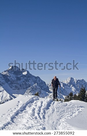 Ski mountaineers ascending the Sch���¶nalpenjoch in the Karwendel mountains - stock photo