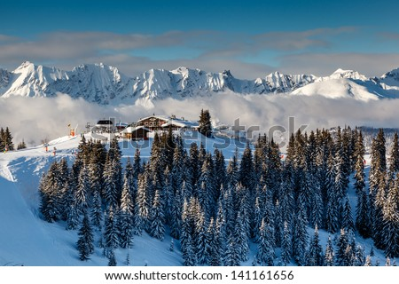 Ski Restaurant on the Mountain Peak near Megeve in French Alps, France - stock photo