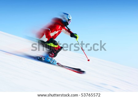 Ski rider in motion. Blurred back and sharp front - stock photo