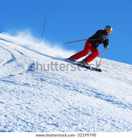 Ski rider on hill - stock photo