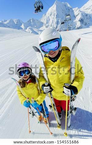 Ski, ski resort, winter sports - family on ski vacation, apres ski - stock photo