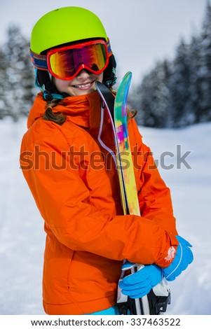 Ski, skier girl enjoying winter vacation - stock photo