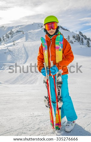 Ski, skier girl on the ski slopes - stock photo