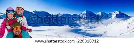 Ski, skier, snow and fun - family enjoying winter vacations, panorama - stock photo