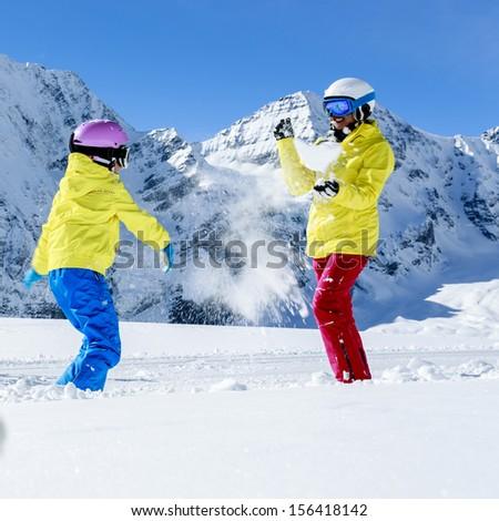 Ski, skier, sun and winter fun - family skiers  enjoying winter holidays - stock photo