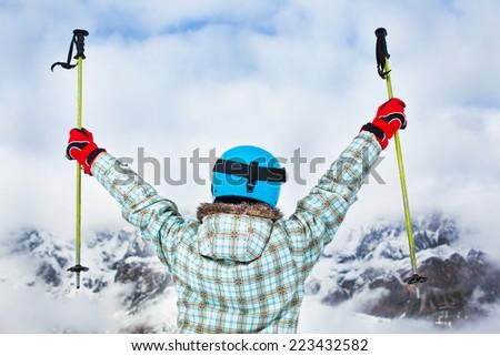Ski, skier, winter - back view of lovely girl has a fun on ski - stock photo
