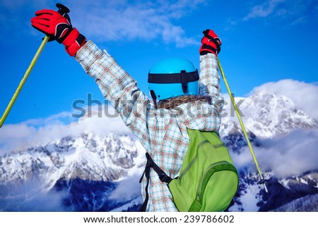 Ski, skier, winter - lovely girl has a fun on ski, back view - stock photo