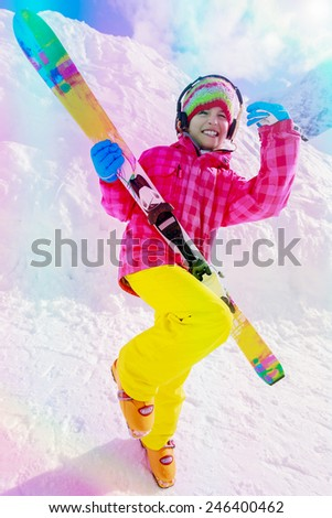 Ski, skier, winter vacation - lovely girl has a fun on ski, filtered - stock photo