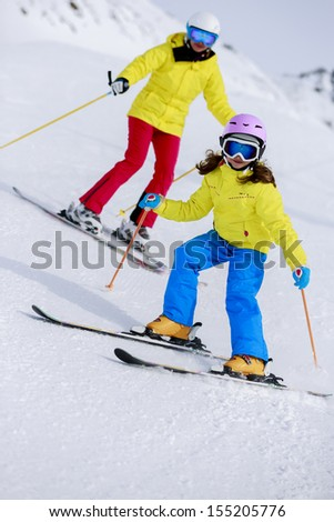 Ski, skiers on ski run - child skiing downhill, ski lesson - stock photo