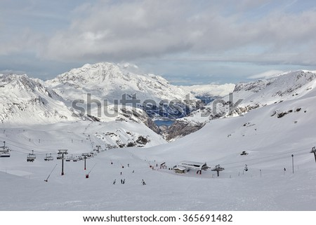 Ski slope and panorama of winter mountains. Alpine ski area Space Killy, France