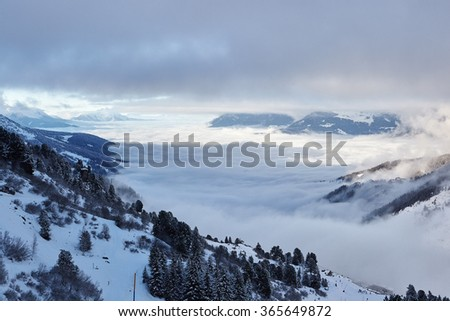 Ski slope and panorama of winter mountains. Alpine ski area The Three Valleys, France