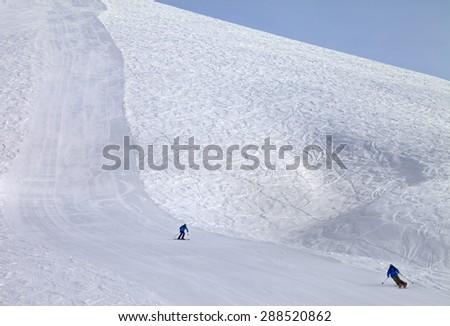 Ski slope and skiers at sun day. Georgia, ski resort Gudauri. Caucasus Mountains. - stock photo