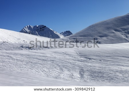 Ski slope at nice sunny morning. Georgia, ski resort Gudauri. Caucasus Mountains. - stock photo