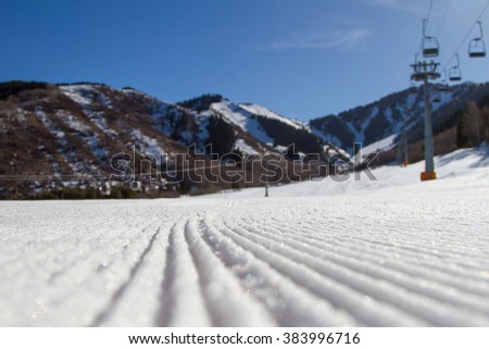 ski slope with ski lifts after a snowcat