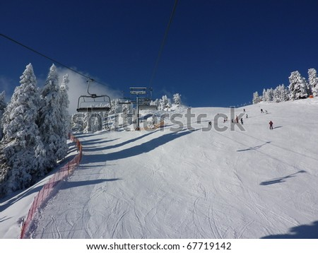 Ski slopes with chair lift and skiers