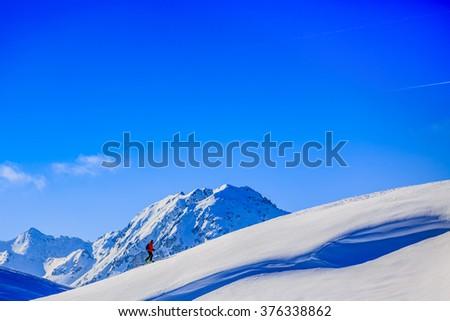 Ski tour - skier climbing to the top - stock photo