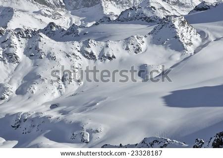 ski tracks in a mountain wilderness, swiss alps - stock photo