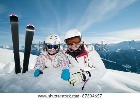 Ski vacation - portrait of skiers in ski resort - stock photo