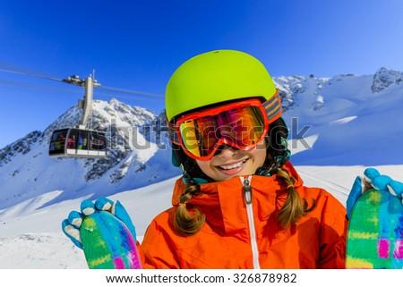 Ski vacation, snow, skier girl enjoying winter - stock photo