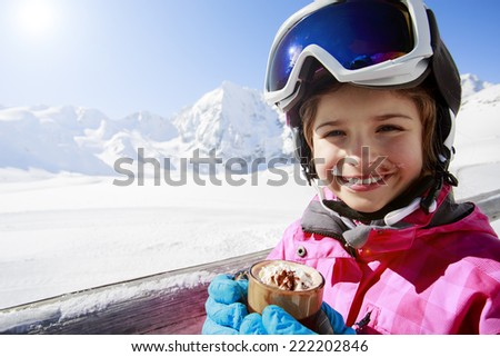 Ski, winter, child - young skier drinking hot chocolate - stock photo