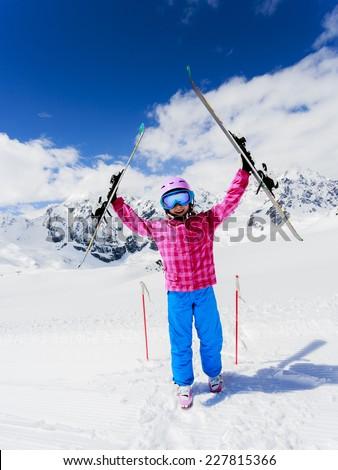 Ski, winter fun - lovely skier girl enjoying ski vacation - stock photo