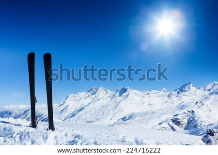 Ski, winter season , mountains and ski equipments. Winter vacation - stock photo