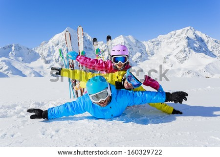 Ski, winter, snow,  skiers, sun and fun - family enjoying winter vacations - stock photo