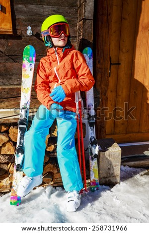 Ski, winter vacation, snow - girl enjoying ski vacations in Swiss Alps - stock photo