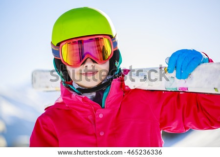 Ski, young skier girl enjoying winter vacation