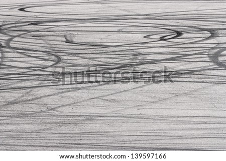 Skid marks on road surface - stock photo