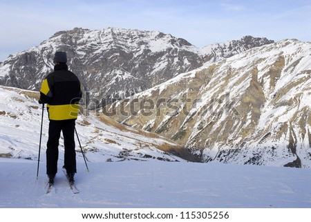 Skier Against Spectacular snow mountains.