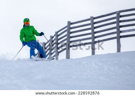Skier coming down the slope with splashes - stock photo
