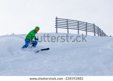 Skier coming down the slope with splashes