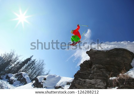 Skier during extreme jump from the rock - stock photo
