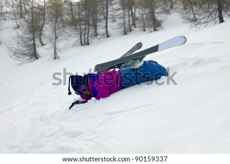 Skier fallen over in the snow - stock photo