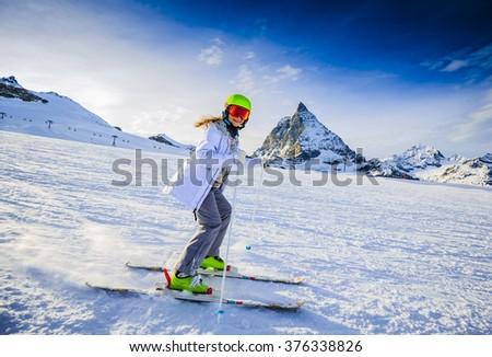 Skier girl with view of Matterhorn - Zermatt, Switzerland - stock photo