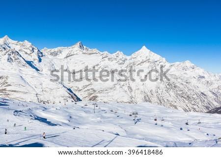 Skier having fun in the perfect area for winter sport - the slopes under the feet of Matterhorn, Zermatt, Switzerland - stock photo