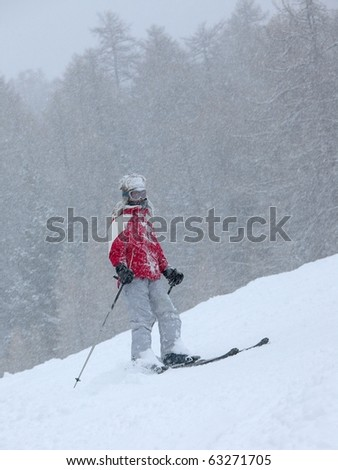 Skier in a heavy snow storm - stock photo
