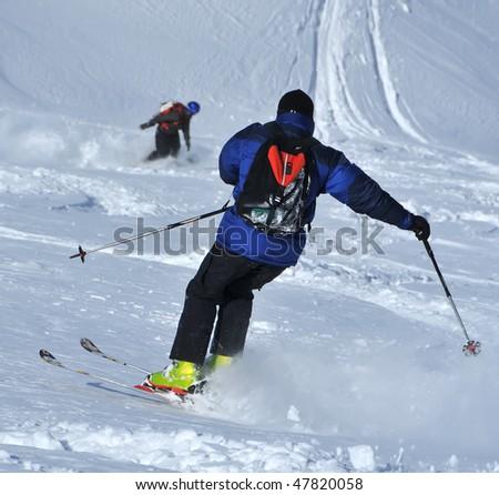 skier in deep powder snow - stock photo