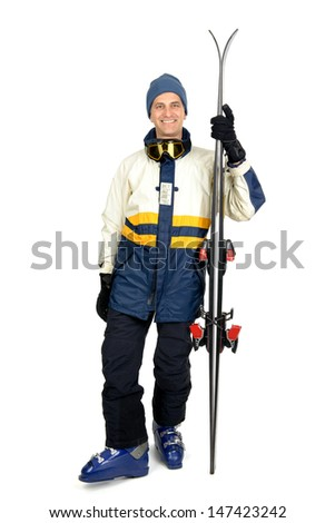 Skier in full gear isolated in white