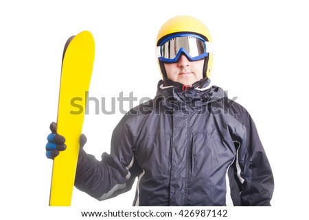 Skier in glasses and helmet, holds ski isolated on white - stock photo