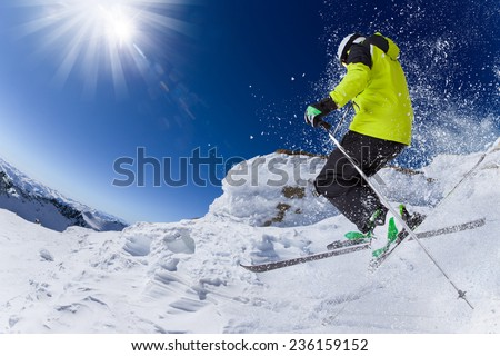 Skier in high mountains during sunny day. - stock photo