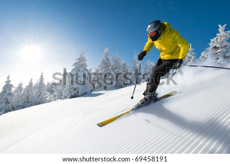 Skier in hight mountain - stock photo