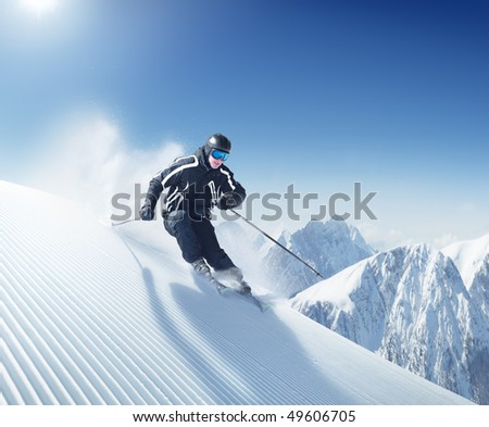 Skier in hight mountains - stock photo