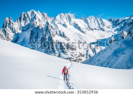 Skier in mountains - stock photo