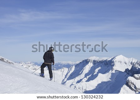 Skier looking over the mountains and slopes.  Flims. Switzerland. - stock photo